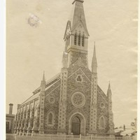 Image: view of church facade and bell tower from Flinders street
