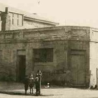 Man and children standing in front of the old Albion Hotel, Morphett Street c.1910