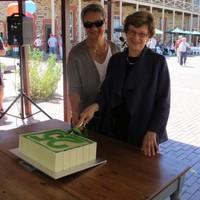 Image: two women cutting cake
