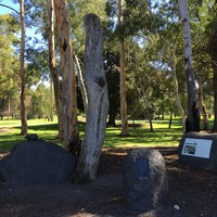 Image: boulders with sculpture and plaques mounted on them