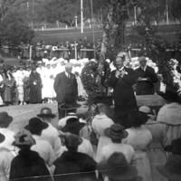 Image: group of people under Union Jack flag