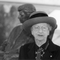 Image: woman in front of sculpture of herself