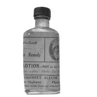 Image: rectangular glass bottle with buff-orange label