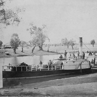 Image: paddle steamer with a number of people standing on top