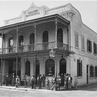 Image: men standing in front of building
