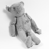 Image: worn teddy bear with stuffing showing