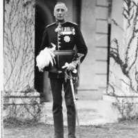 Image: Informal portrait of South Australia's new Governor, taken on the day of his swearing in. He stands, facing the camera, in full dress uniform including sword, plumed helmet and spurs. On his chest he wears an array of medals and orders.