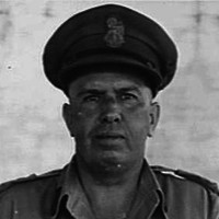Image: Photographic head-and-shoulders portrait of a middle-aged Caucasian man in the uniform of a high-ranking Australian Army officer