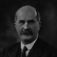 Image: Head and shoulder shot of bald man wearing suit