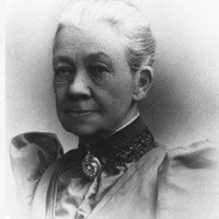 Image: black and white photo of head and shoulders of older woman