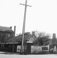 Image: view of a street corner with telephone box and poles