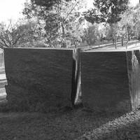 image: memorial of large granite stone split in two