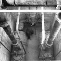Image: view from above of man amongst large pipes