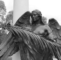 Image: Bronze statue of female angel with leaves