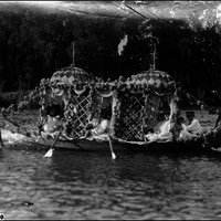 Image: row boat decorated with flowers