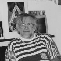 Image: man sitting in living room