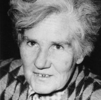 Image: head shot of a woman with white hair