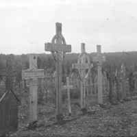 Image: black and white picture of grave site crosses