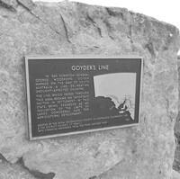 Image: bronze plaque on large stone