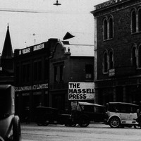 Image: View of shop fronts and cars along currie street
