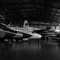 Image: group of planes in large hanger style building