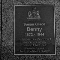 Bronze plaque set in pavement inscribed with name and City of Adelaide logo
